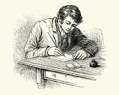 Young victorian man writing a letter