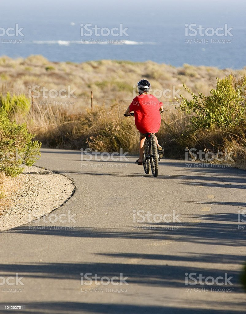 YOUNG BIKE RIDER stock photo
