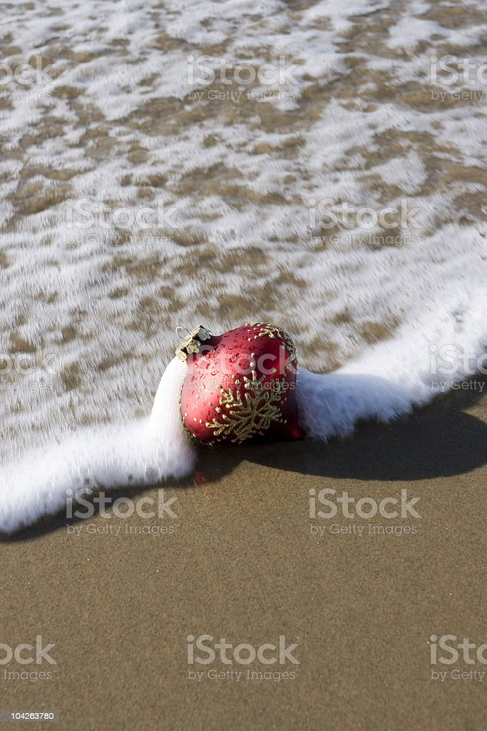CHRISTMAS ORNAMENT AT THE BEACH royalty-free stock photo
