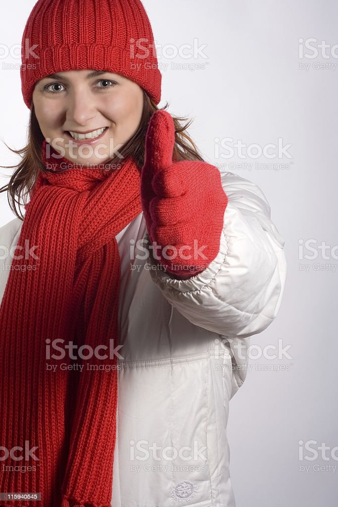 WOMAN THUMBS UP IN WINTER CLOTHES royalty-free stock photo