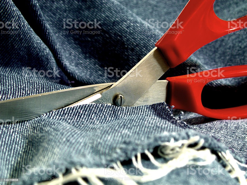 SCISSORS AND JEANS royalty-free stock photo