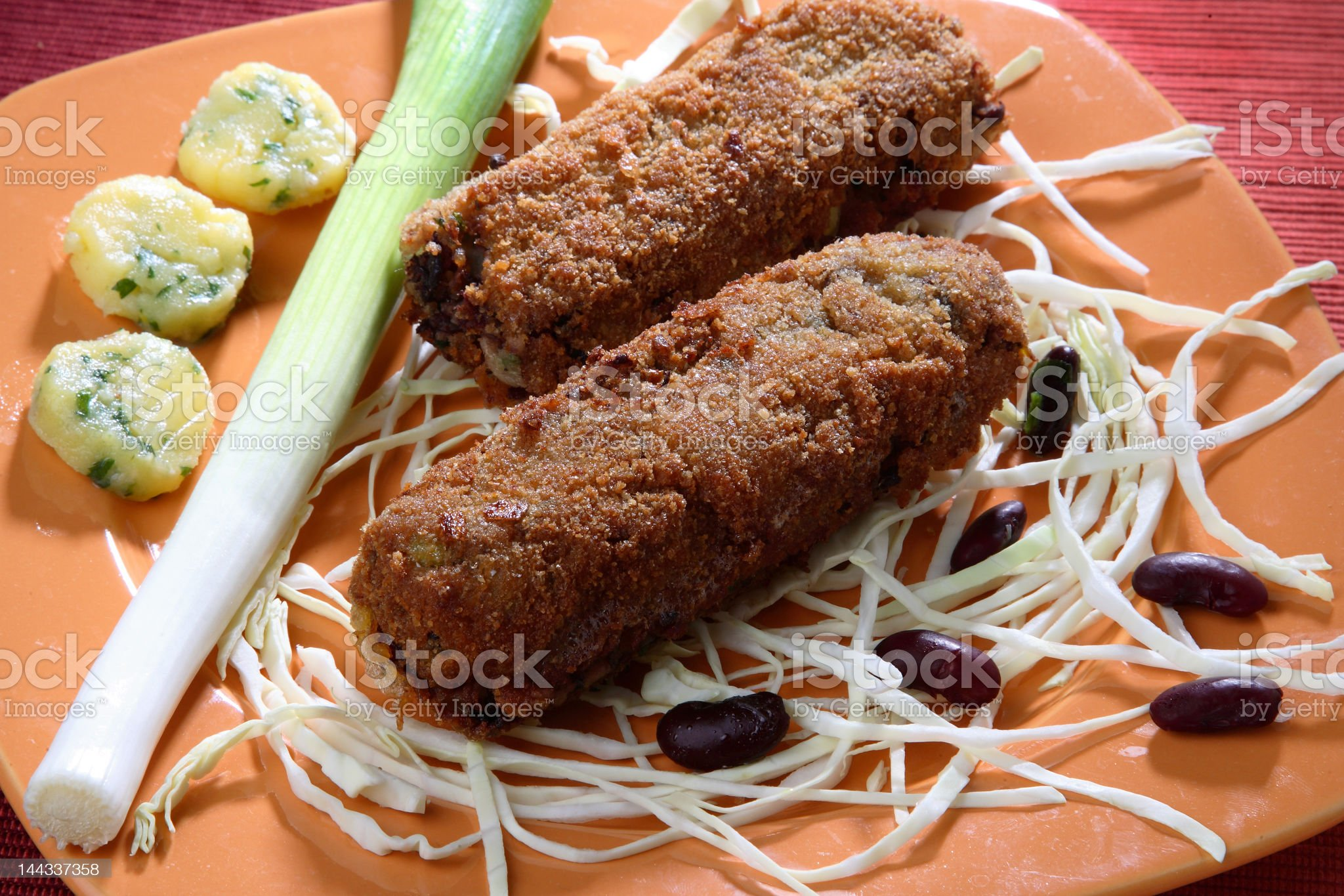 BREADED DEEP FRIED BEANS WITH FRESH LEEK AND CABBAGE royalty-free stock photo