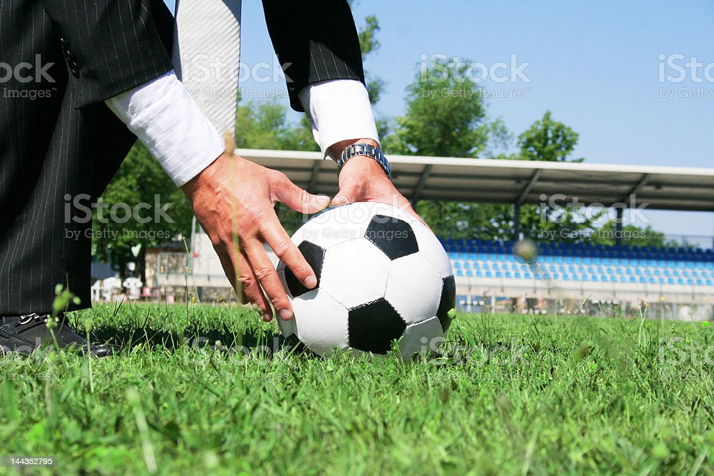 BUSINESS MAN PLAYING FOOTBALL royalty-free stock photo