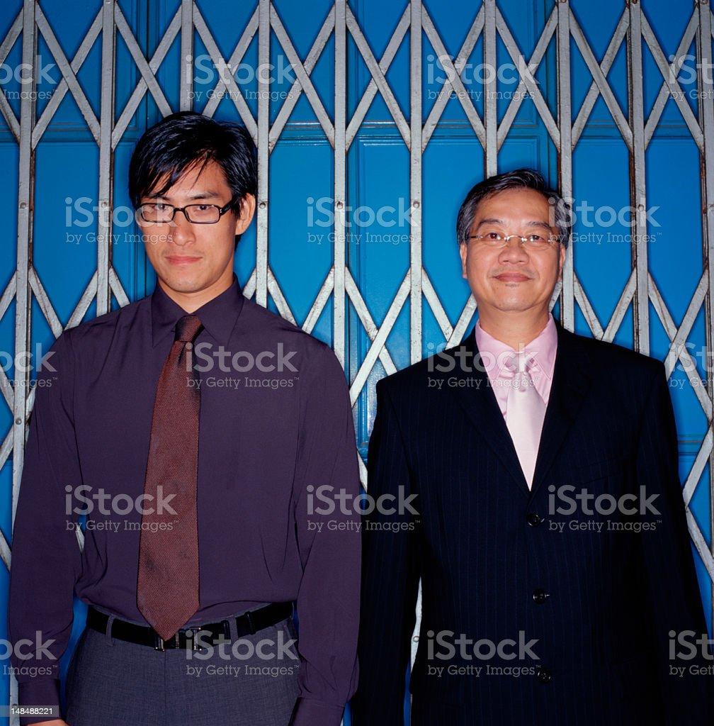 TWO BUSINESSMEN IN ELEVATOR stock photo