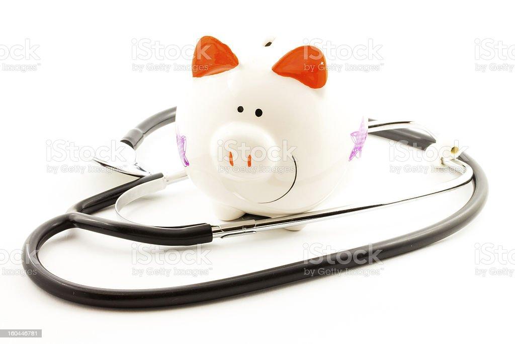 HEALTH INSURANCE PIGGY BANK royalty-free stock photo