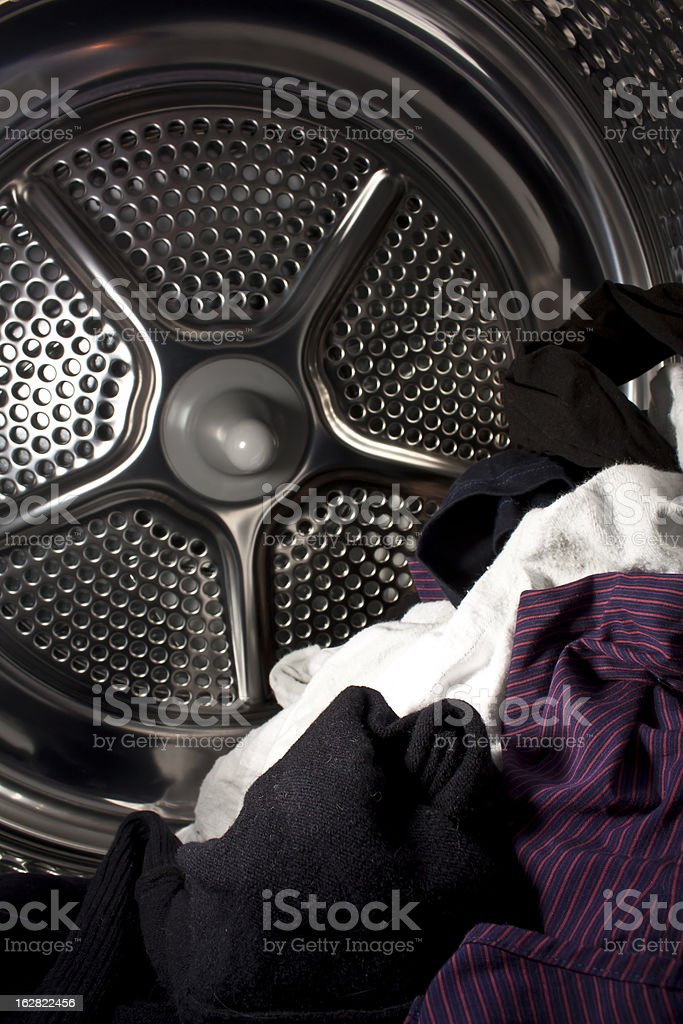 clothes in metal dryer stock photo