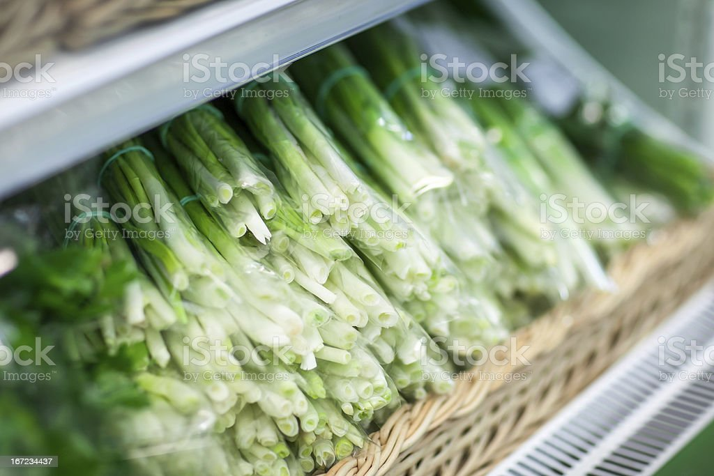 HEAP OF GREEN ONION IN SUPERMARKET royalty-free stock photo
