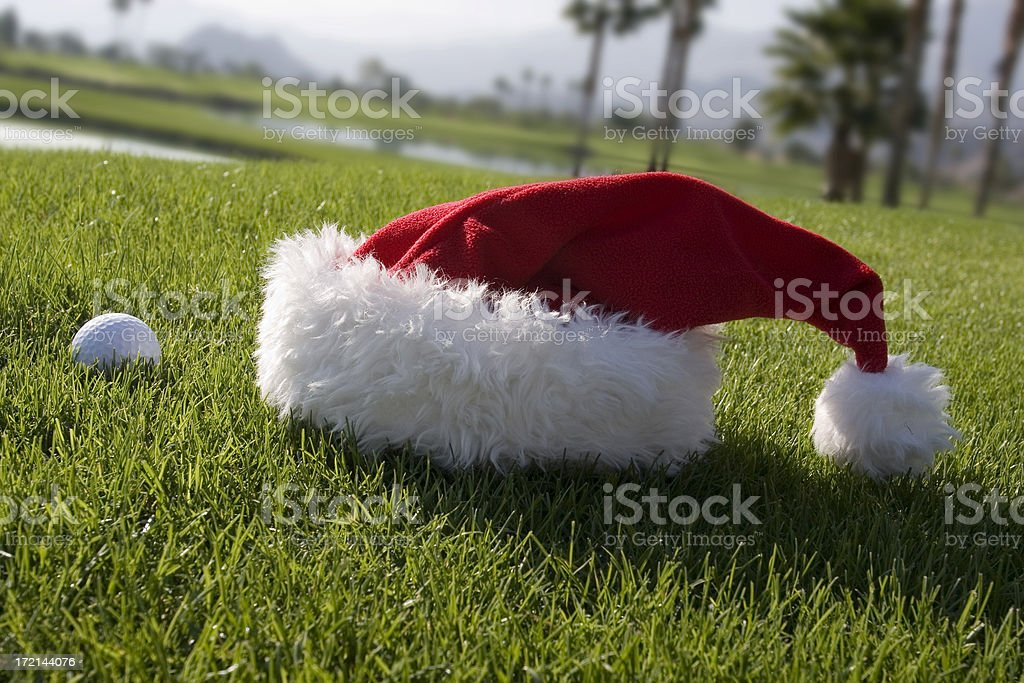 SANTA HAT WITH GOLF BALL stock photo