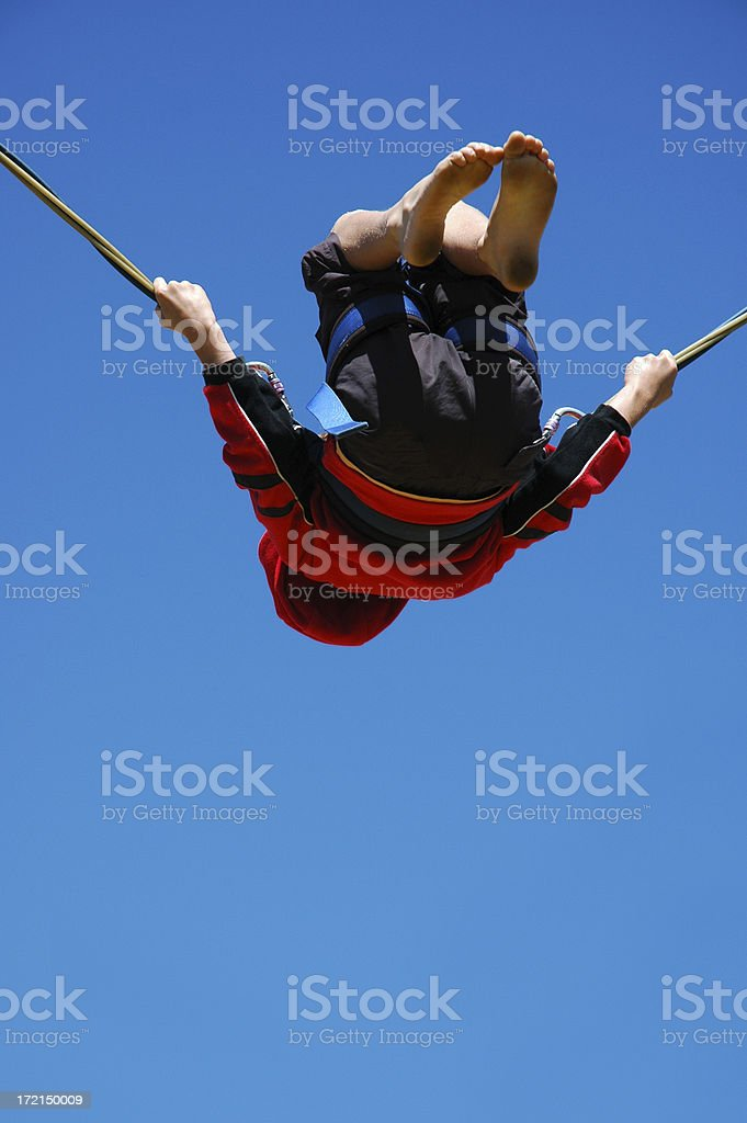 BOY ON INVERTED BUNGY royalty-free stock photo