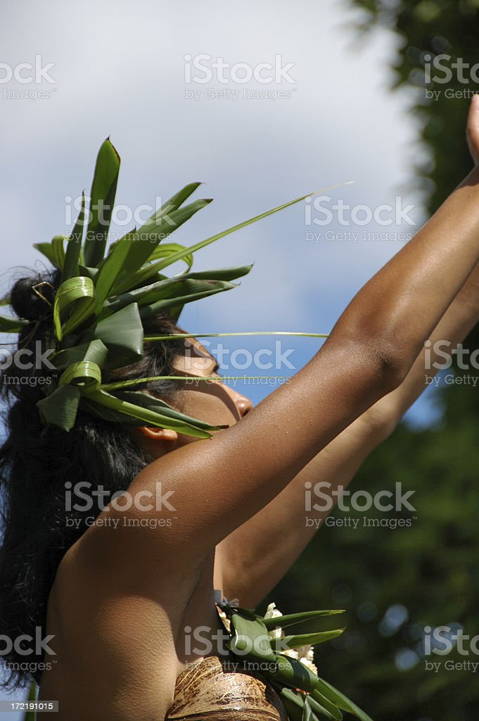 PACIFIC ISLAND COSTUMED GIRL SALUTES THE SUN royalty-free stock photo