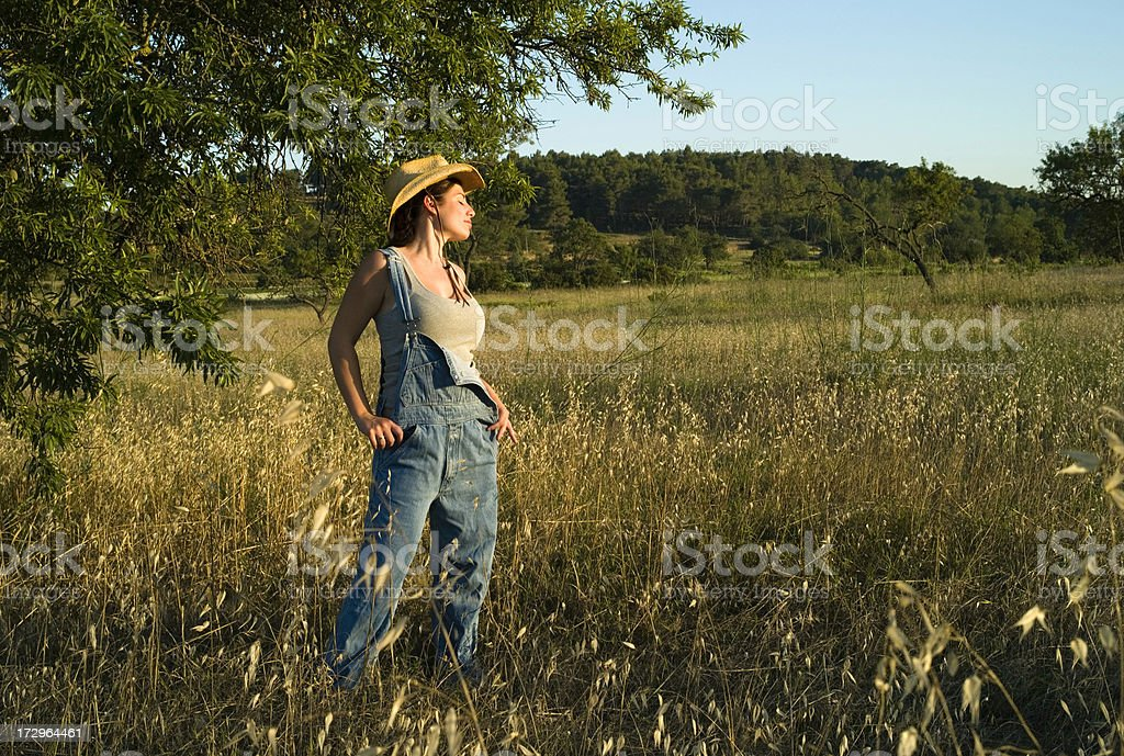 FARMER GIRL ON SUNSET stock photo