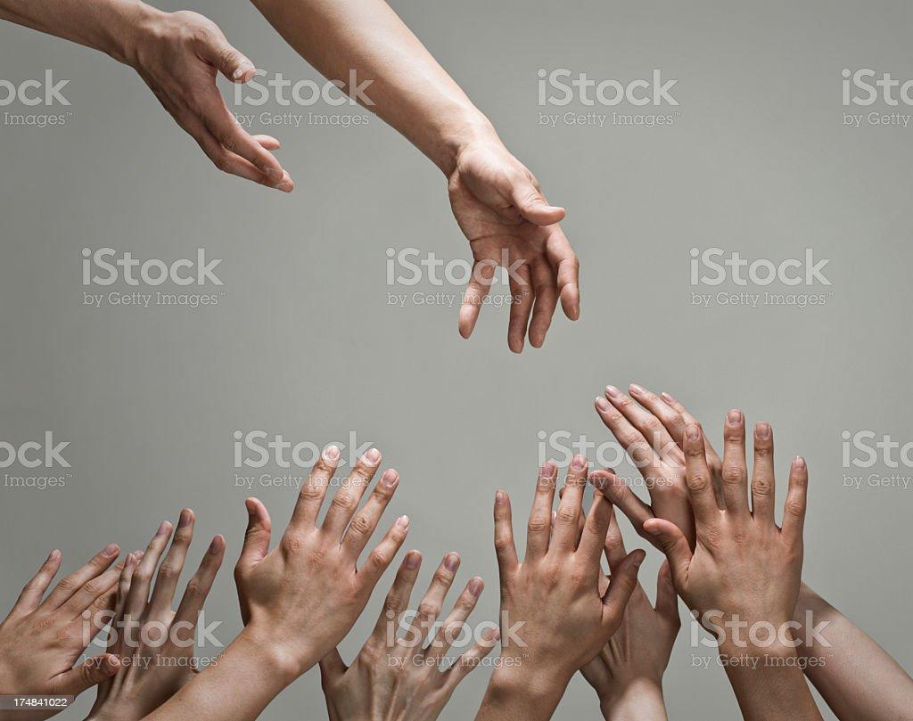 差し伸べられる手。 stock photo
