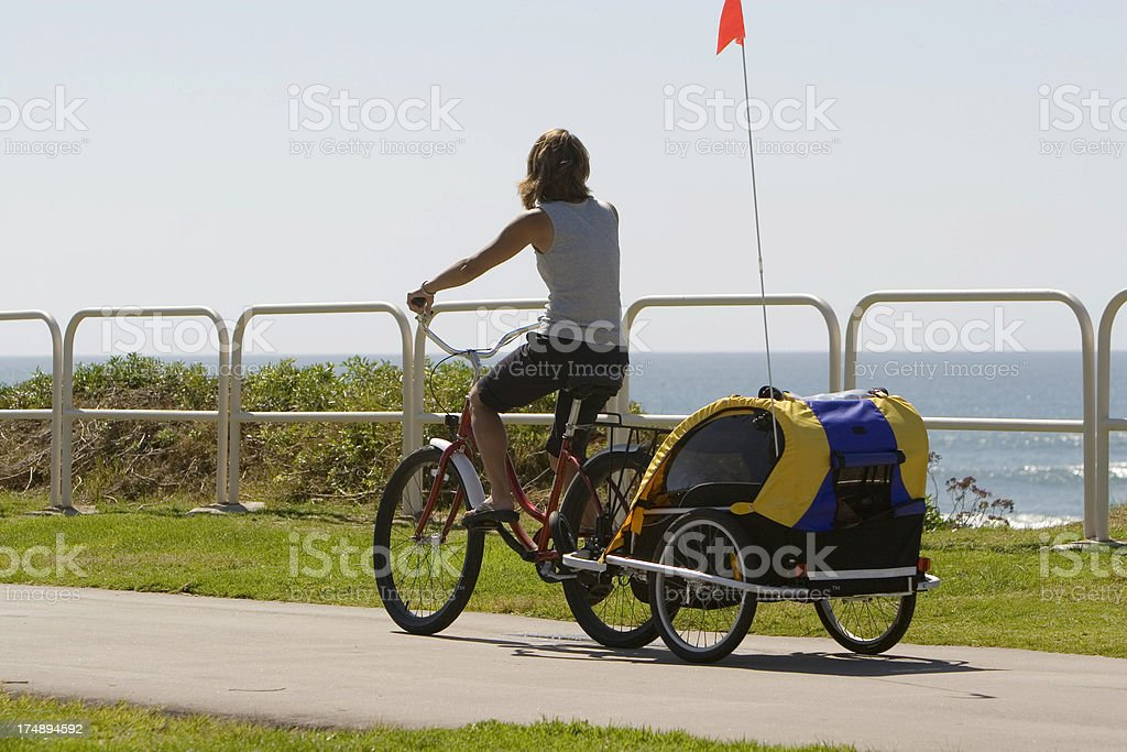 MOTHER ON BIKE WITH CHILD stock photo