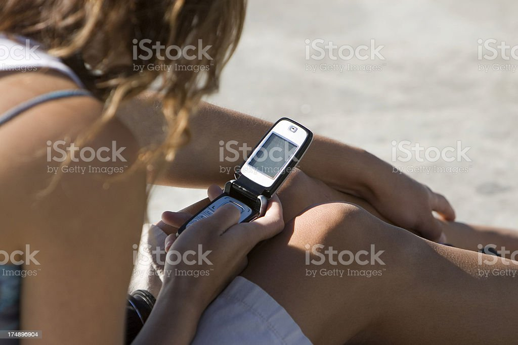 GIRL WITH CELL PHONE royalty-free stock photo