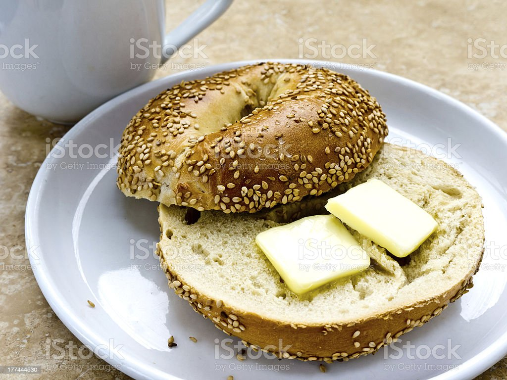 SESAME SEED BAGEL WITH BUTTER stock photo