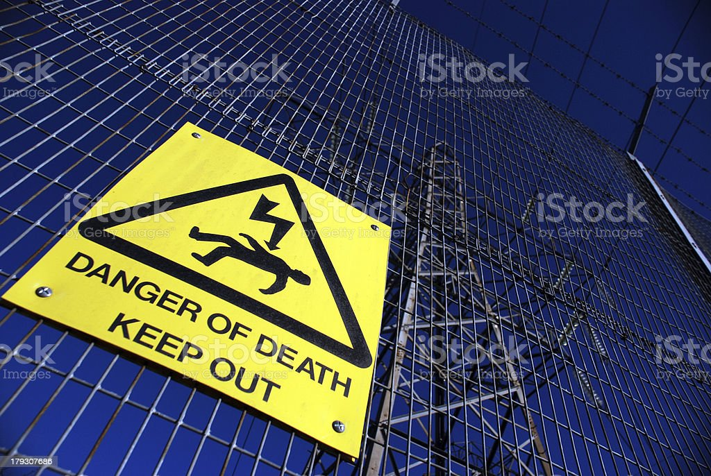 DANGER SIGN, PYLON AND SKY stock photo