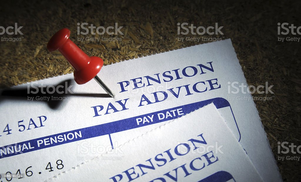 PRIVATE PENSION PAY ADVICE ON NOTICE BOARD WITH PIN stock photo