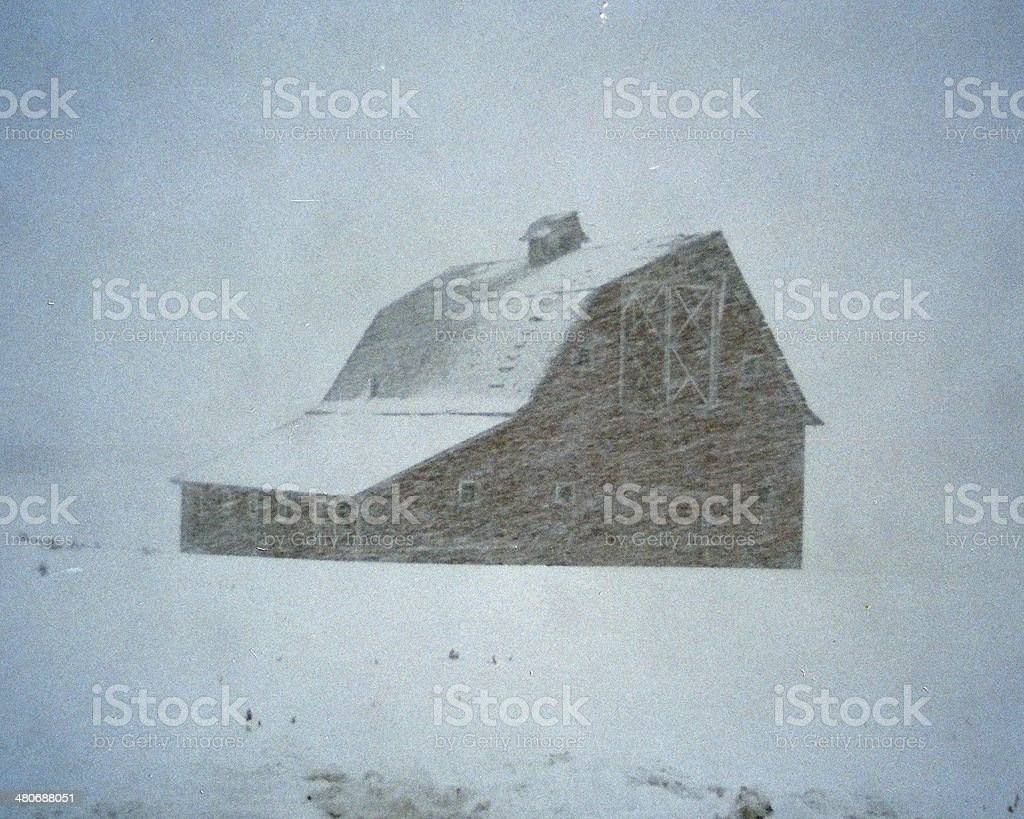 OLD MONTANA BARN IN SNOW STORM. stock photo