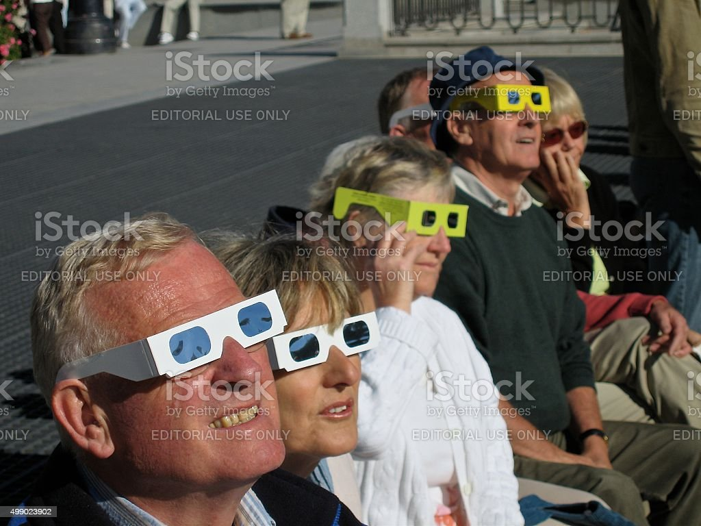 PEOPLE WATCHING ECLIPSE stock photo