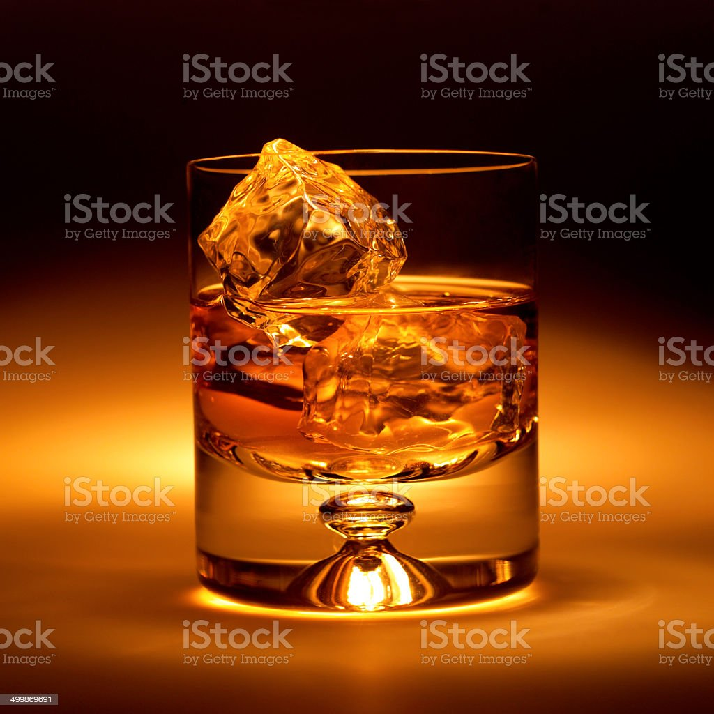 GLASS WITH ICE AND WHISKY stock photo
