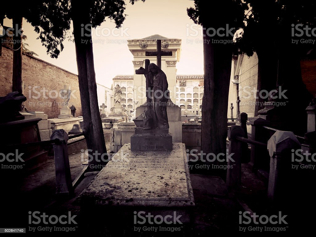 ANCIENT GRAVES AT CEMETERY IN AUTUMN MORNING stock photo