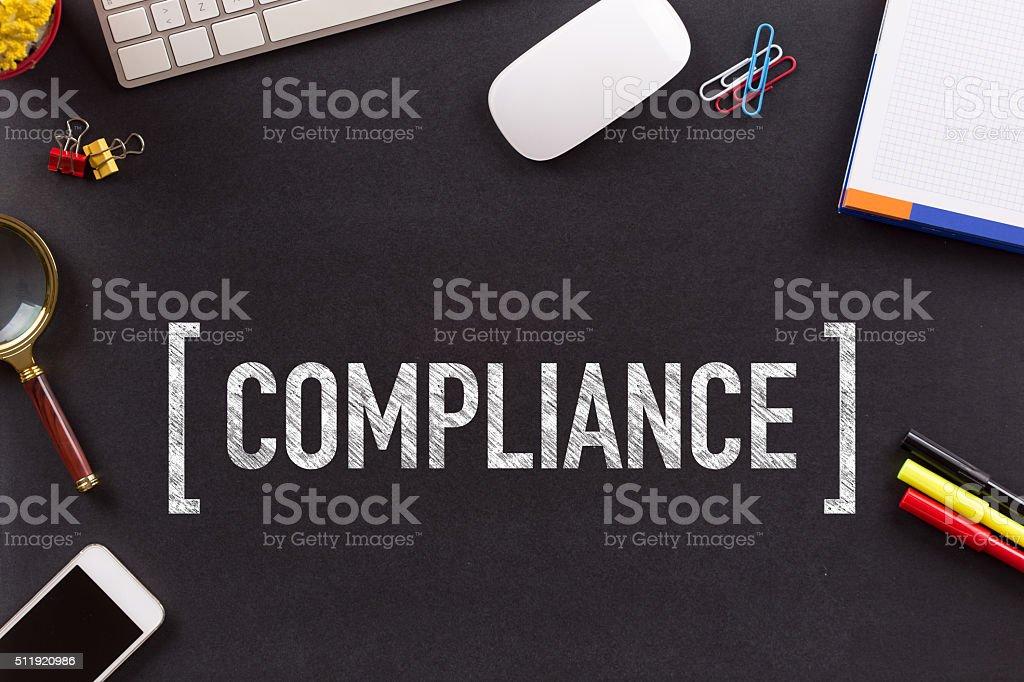 COMPLIANCE CONCEPT ON BLACKBOARD stock photo
