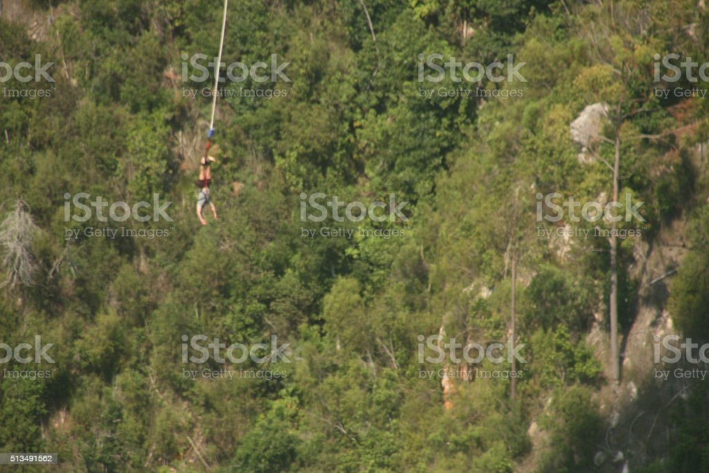 BUNGY JUMPER SUSPENDED AFTER JUMPING FROM A BRIDGE stock photo