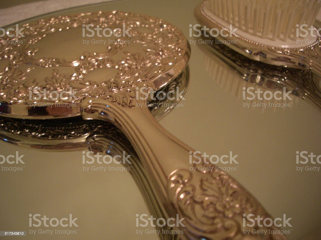 ANTIQUE MIRROR AND BRUSH SET stock photo