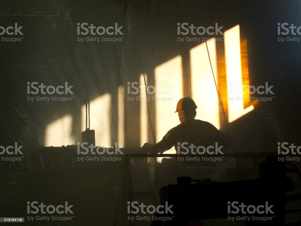 MORNING WORKER SILHOUETTE stock photo