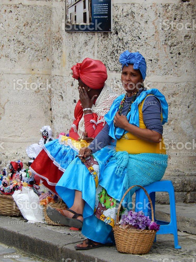 LADIES IN COLORFUL DRESSES, HAVANA, CUBA stock photo
