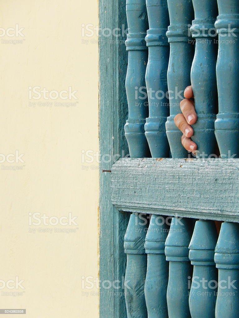 WINDOW AND FINGERS, TRINIDAD, CUBA stock photo
