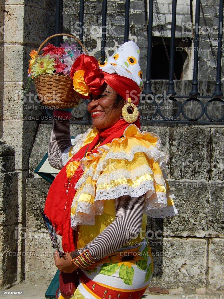 CUBAN WOMAN IN TRADITIONAL COLORFUL DRESS, HAVANA, CUBA stock photo