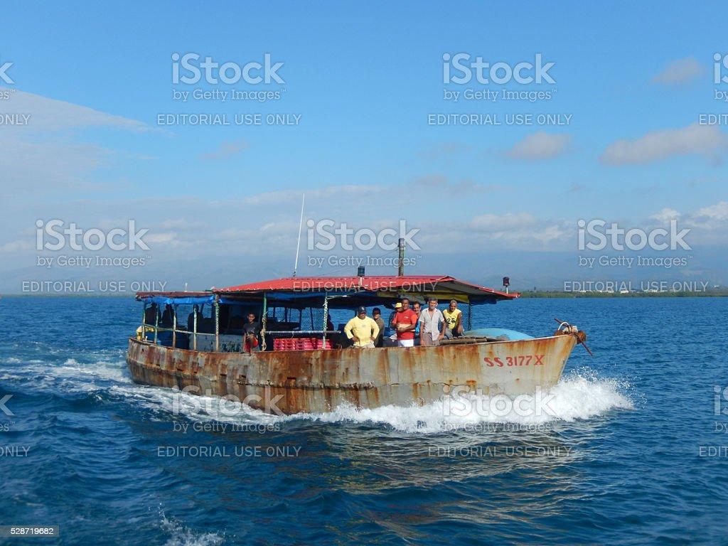 RUSTY OLD TIN BOAT ON THE CARIBBEAN SEA, CUBA stock photo