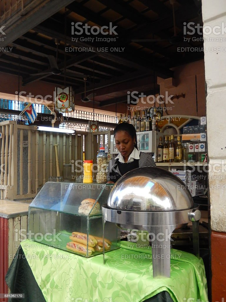 CUBAN GIRL SELLING SANDWICHES, ALCOHOL AND CIGARETTES, HAVANA CUBA stock photo