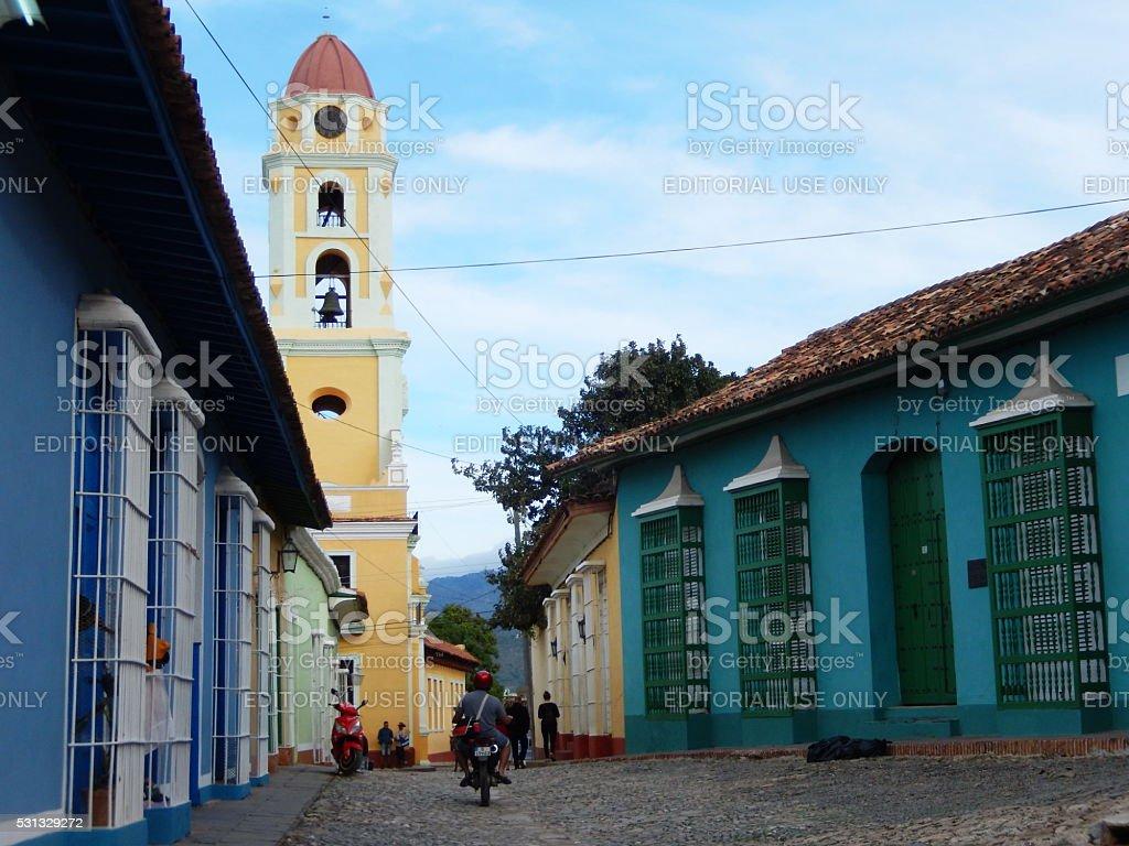 COLORFUL FACADES AND THE CHURCH OF SAINT FRANCIS, TRINIDAD, CUBA stock photo