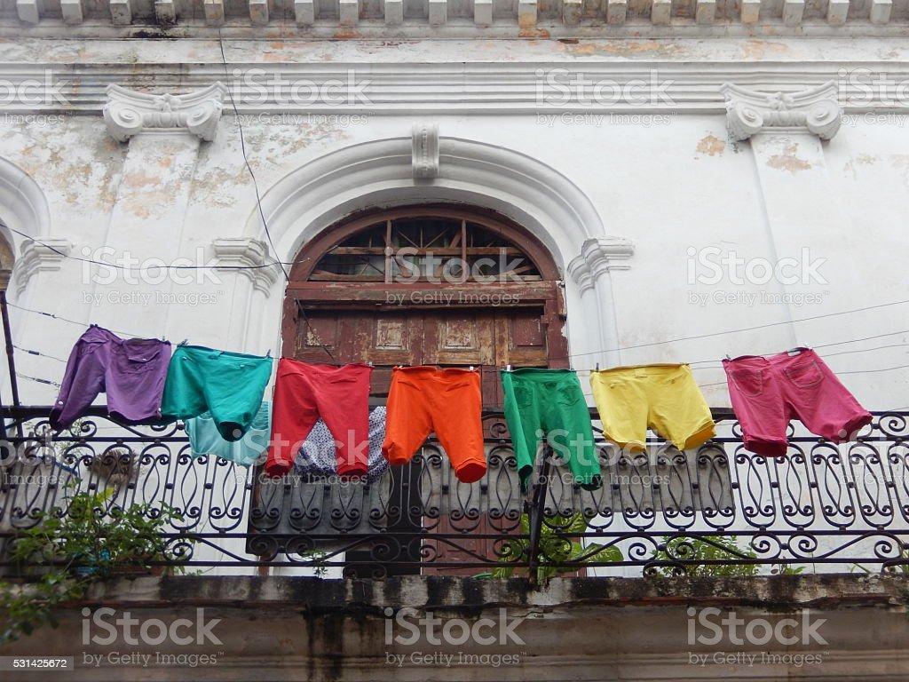 COLORFUL SHORTS, LAUNDRY ON A BALCONY, HAVANA, CUBA stock photo