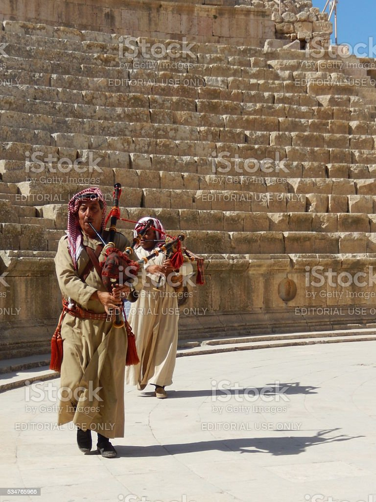 JORDANIANS PLAYING BAGPIPE IN JERASH, JORDAN stock photo
