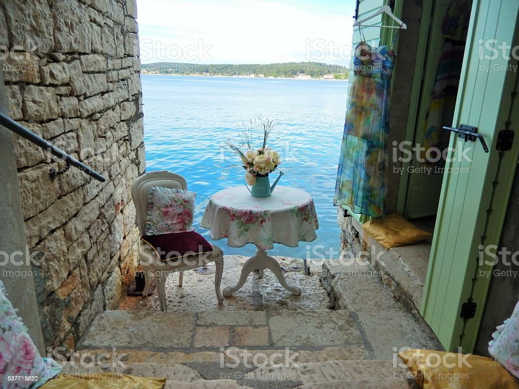 STONE STAIRS, ROMANTIC PILLOWS AND WHITE CHAIR, ROVINJ, CROATIA stock photo