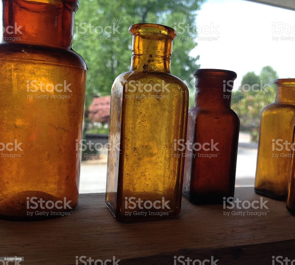 ANTIQUE BOTTLES IN THE WINDOW stock photo