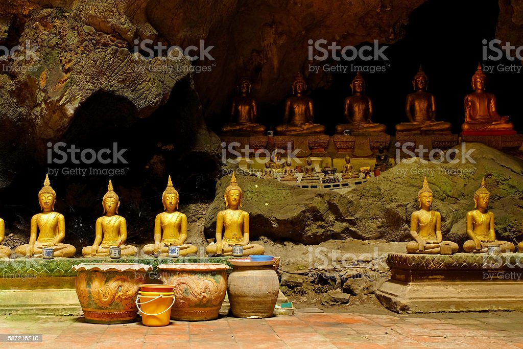 BUDDHA  IMAGES IN A CAVE stock photo