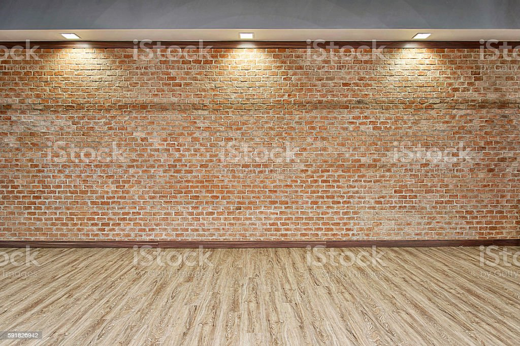 BRICK WALL WITH WOOD FLOOR BACKGROUND stock photo