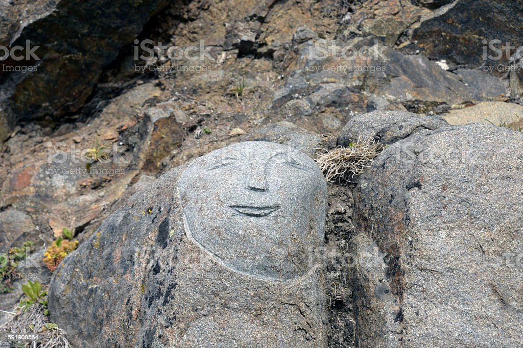 GREENLAND STONE FACE SCULPTURE stock photo