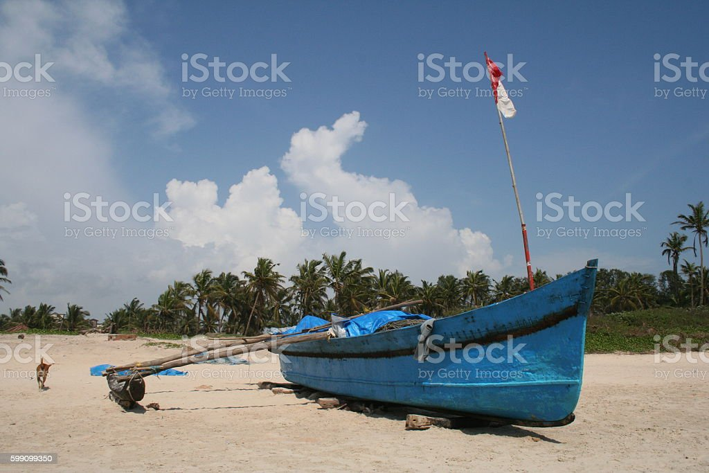 TRADITIONAL FISHING BOAT IN GOA stock photo