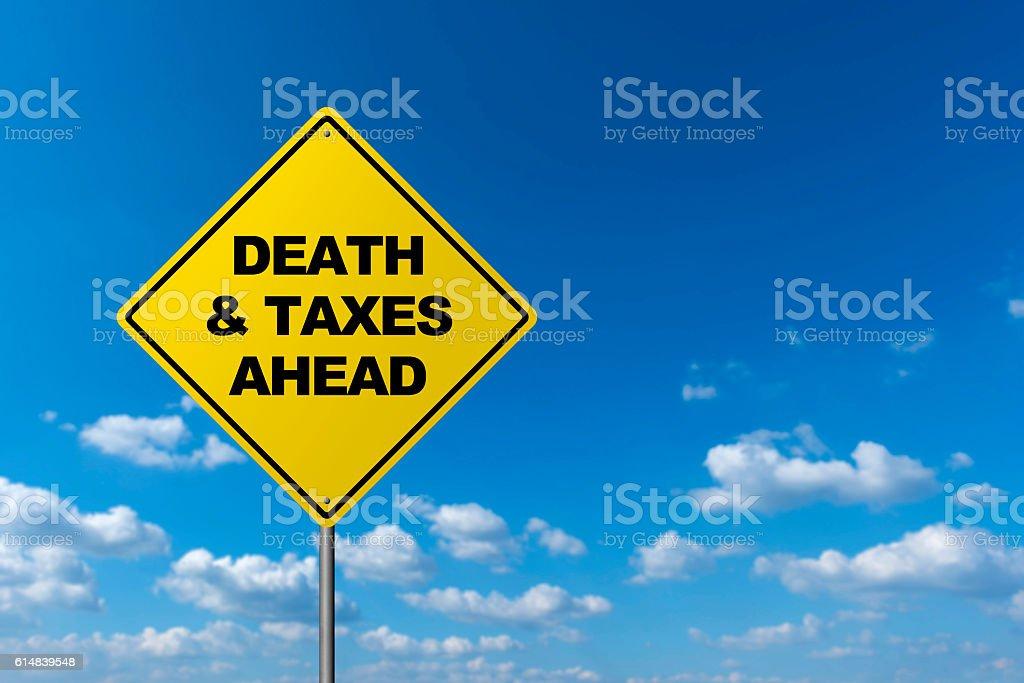 DEATH & TAXES AHEAD stock photo