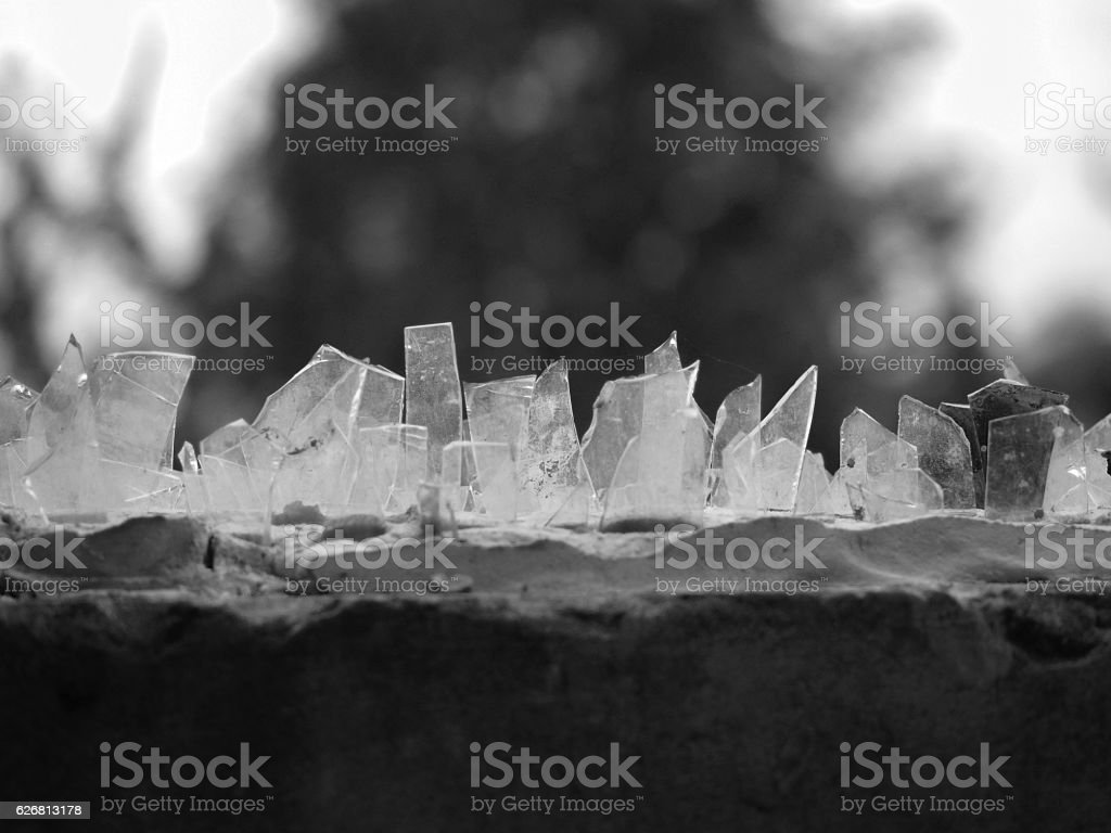GLASS PIECES ON THE HOUSE FENCE stock photo