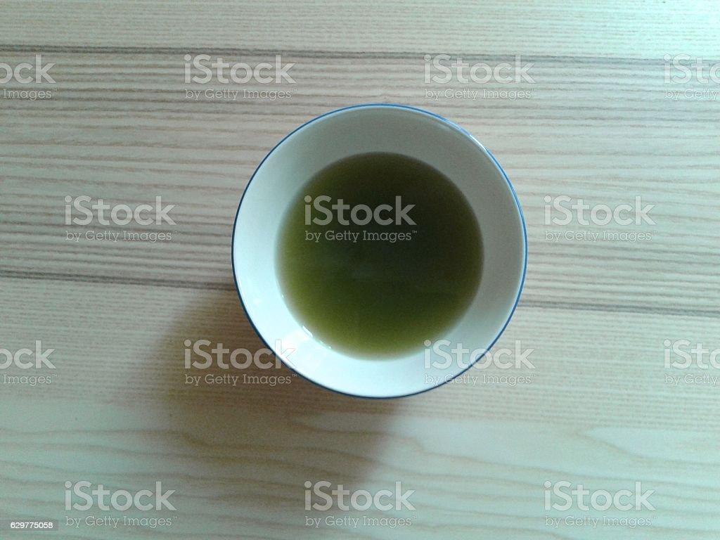 BOWL WITH TEA stock photo