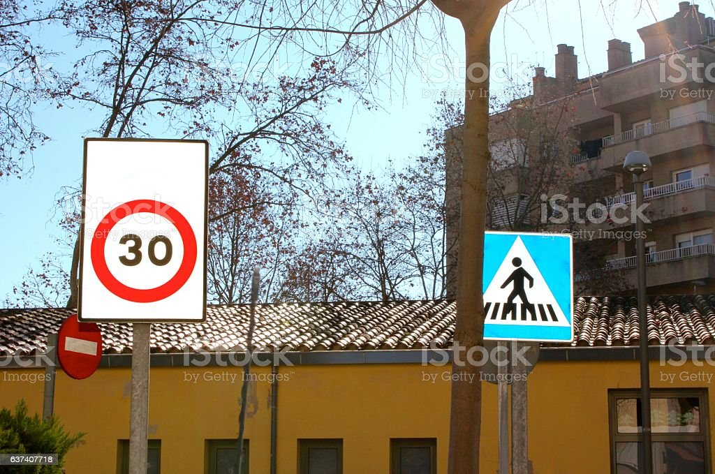 STREET AND THREE TRAFFIC SIGNS stock photo