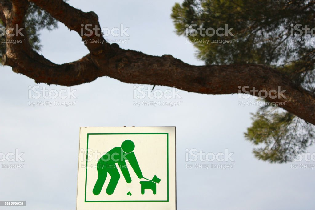PICK UP AFTER YOUR DOG stock photo