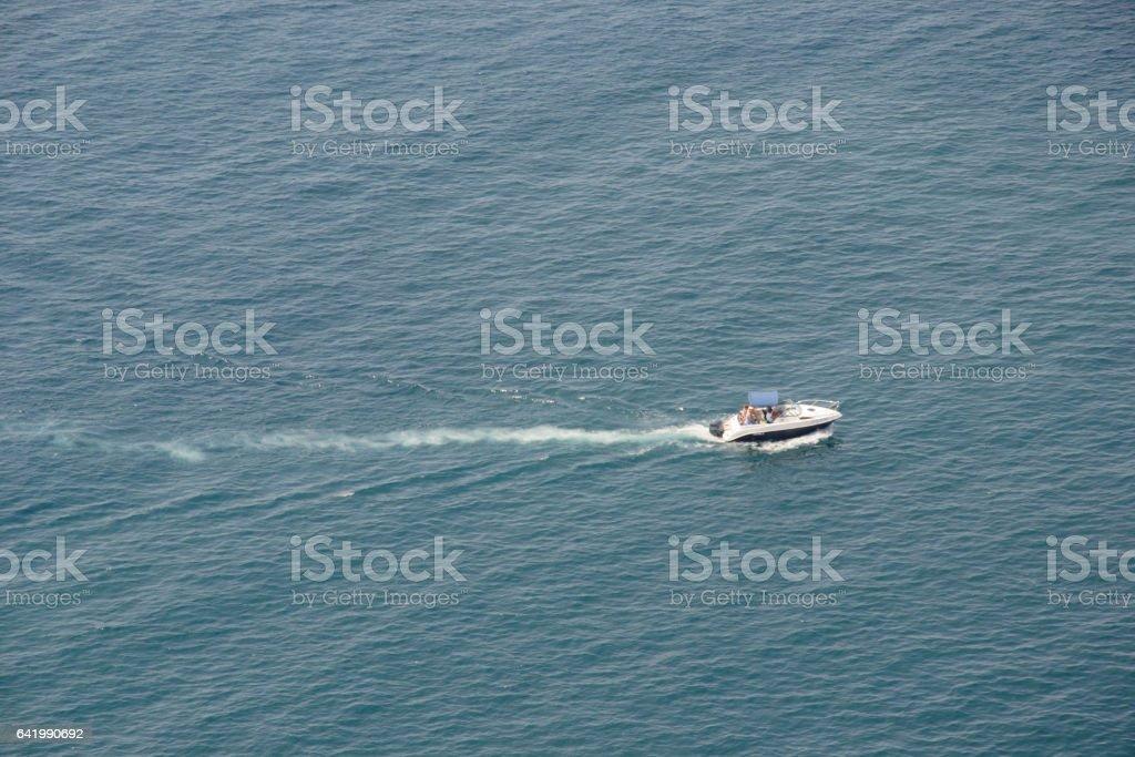 моторная лодка плывет по морю stock photo