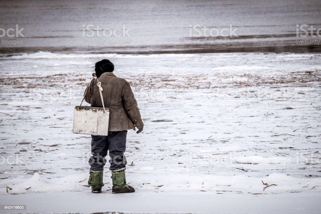 Зимняя рыбалка на реке stock photo